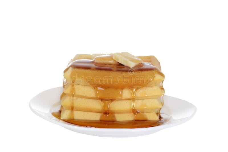 Geïsoleerdeg Wafels met boter en stroop royalty-vrije stock fotografie