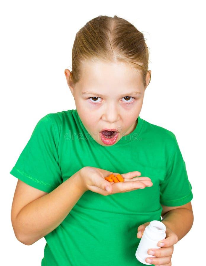 Geïsoleerds meisje met oranje pillen royalty-vrije stock afbeeldingen