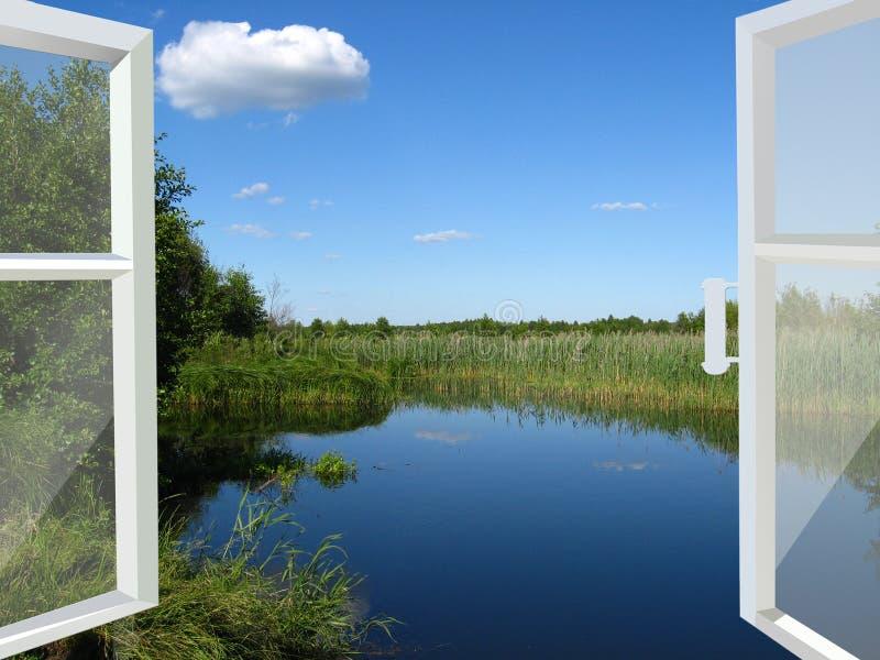 Geöffnetes Fenster zum See und zur Wiese stockfoto