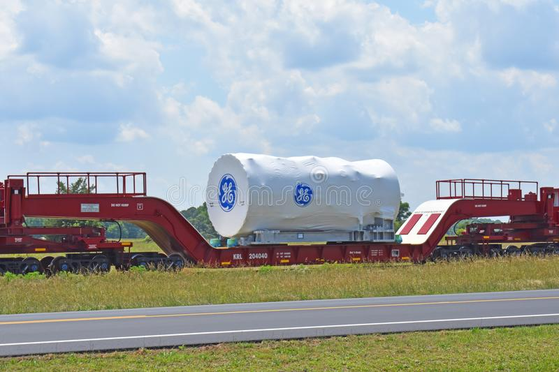 A GE Power turbine being transported for export. A GE Power gas turbine is transported by rail to the Port of Charleston for export on June 9 2018. GE Power royalty free stock photography