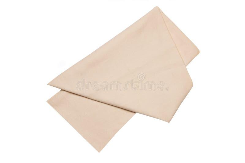 Ge?soleerded handdoeken Close-up van een beige servet of picknicktafelkleedtextuur die op een witte achtergrond wordt ge?soleerd  stock fotografie