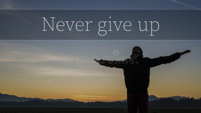 Ge upp aldrig det motivational begreppet royaltyfri fotografi