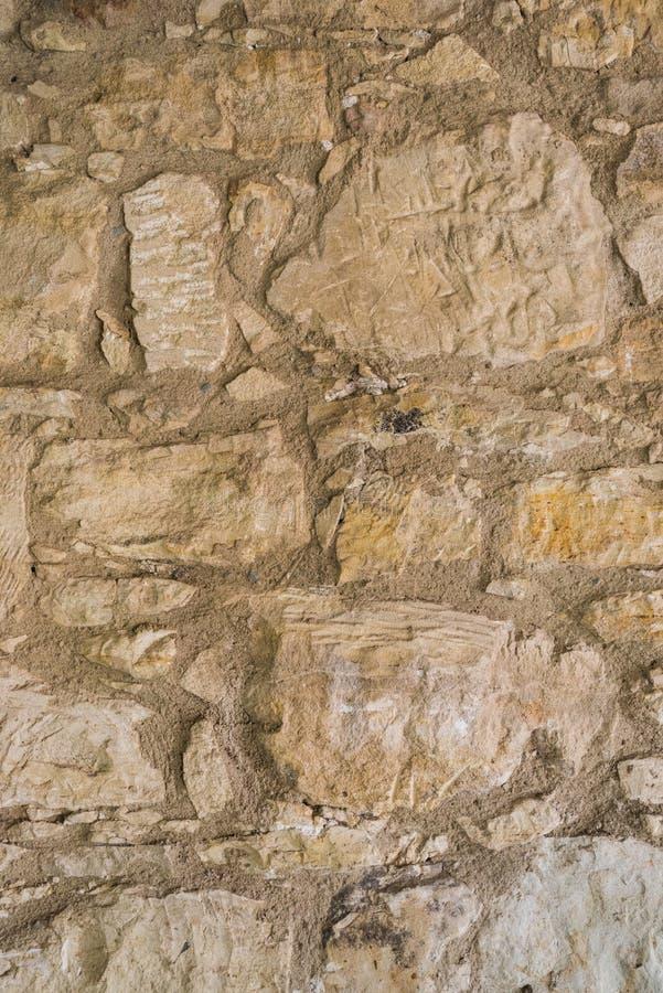 Gealterte Felsspitzensteinwandbeschaffenheit oder -hintergrund stockbild