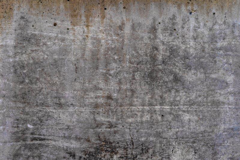 Gealterter Beton mit orange Fleckmustern und Sprüngen - Beschaffenheit der hohen Qualität/Hintergrund stockbild