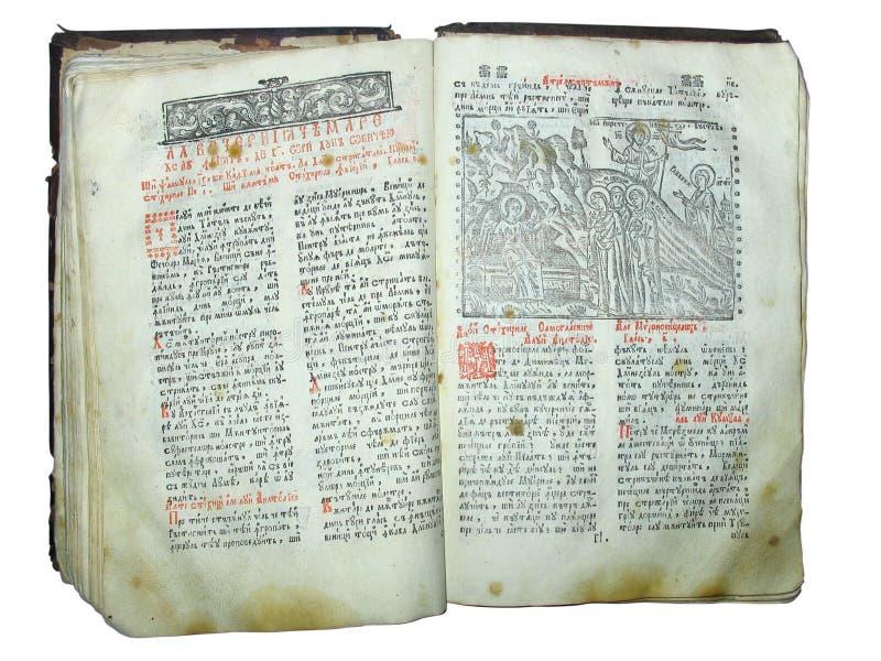 Gealtertes altes frommes geöffnetes Buch getrennt stockfotos