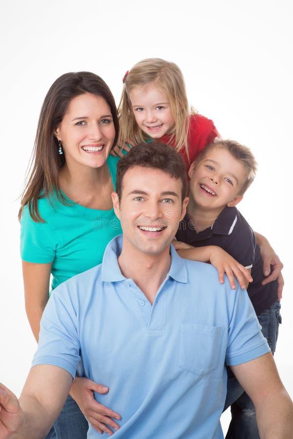 Geamuseerde familie op witte achtergrond royalty-vrije stock foto's