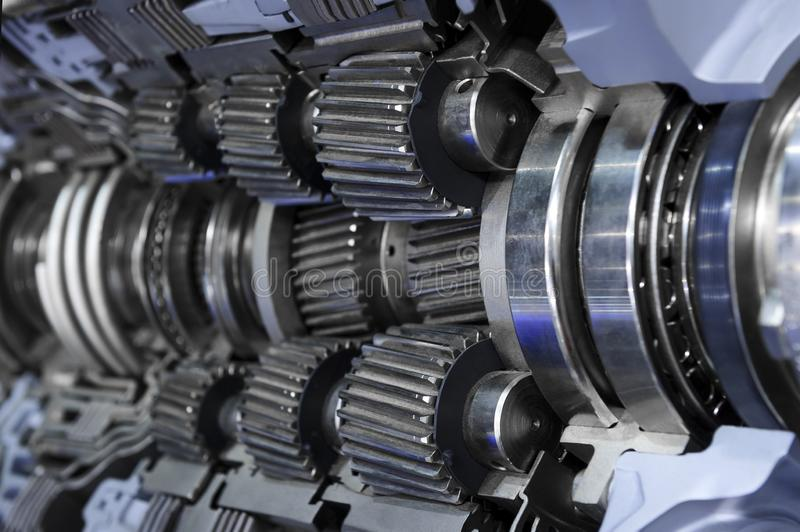 Gear box cross section. Engine industry, sprockets, cogwheels and bearings of automotive transmission for oversize trucks and construction vehicles, selective royalty free stock photo