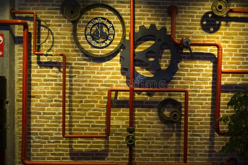 Gear combinations and pipes, building decoration restoring ancient ways. Steampunk mechanical cogs gears wheels stock image
