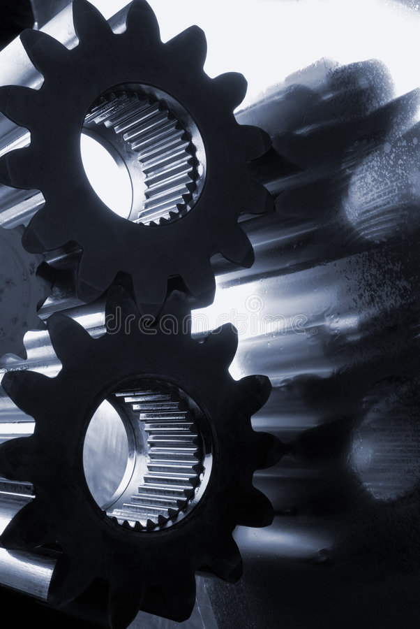 Gear-machinery, blue silhouetted royalty free stock photos