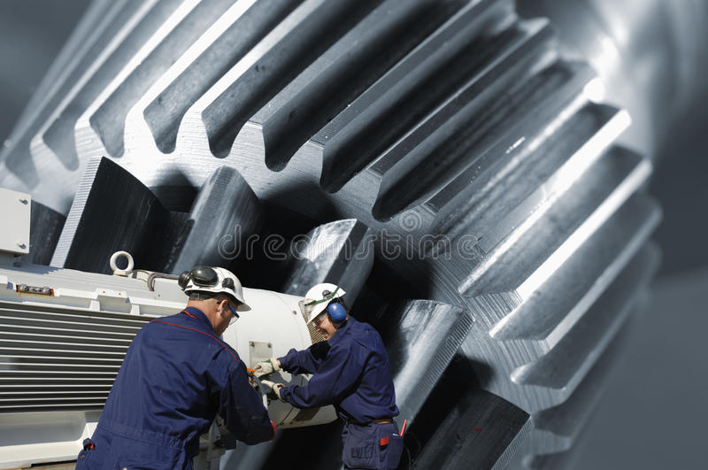 Gear machinery and workers royalty free stock image