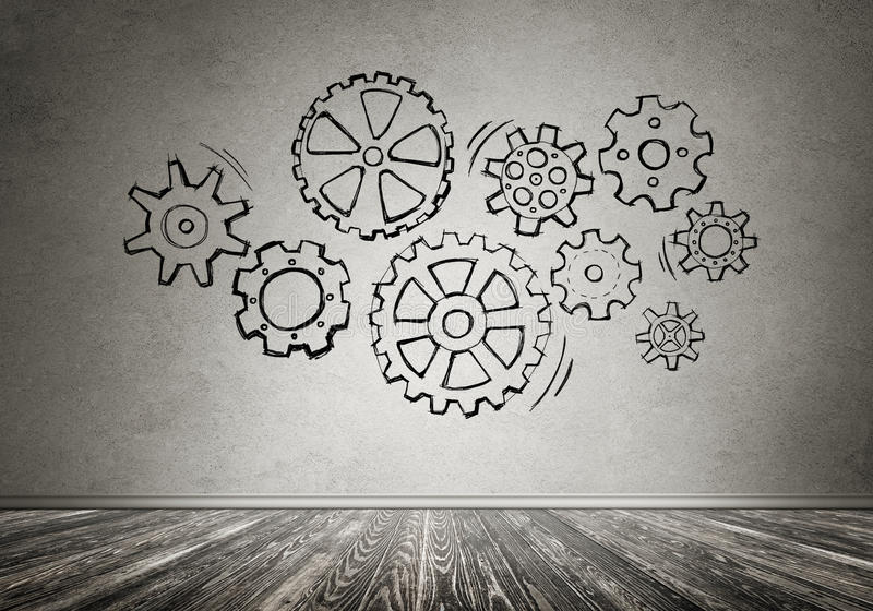 Gear mechanism as teamwork concept. Gear hand drawn mechanism on gray wall royalty free stock images