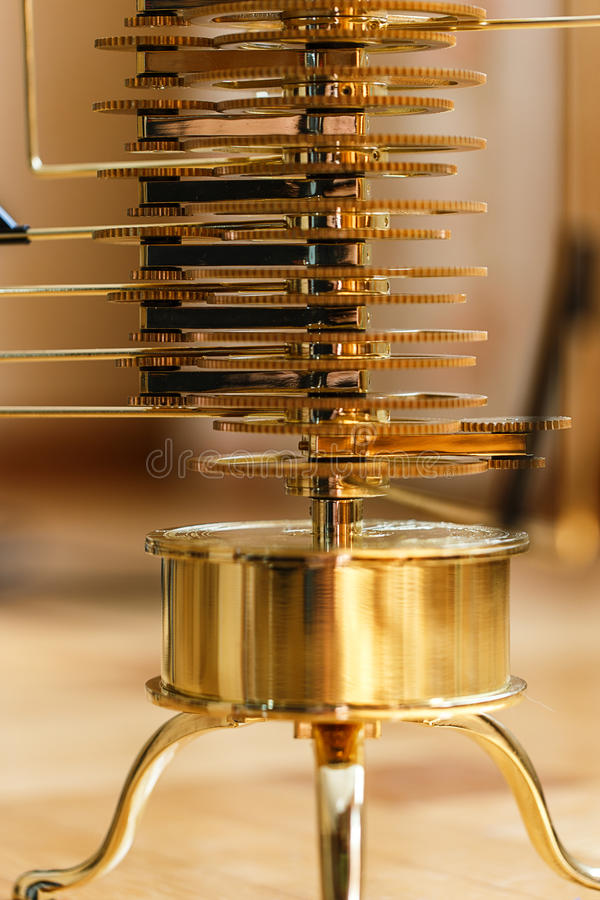 Gear mechanism. Yellow gold color stock images