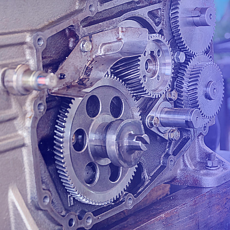 Gear metal wheels close-up. Gears and cogs macro, blue toned stock photography