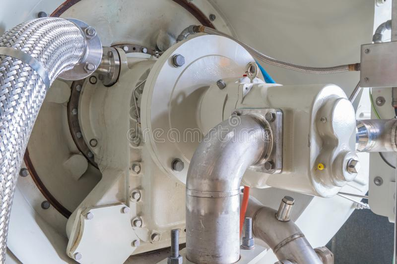 Gear pump and bearing housing at air intake of power turbine engine. stock photo