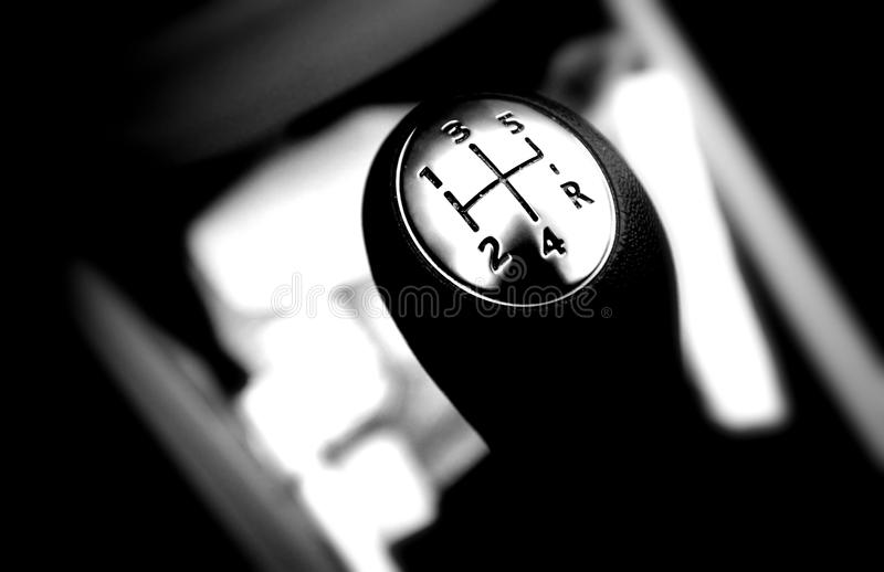 Gear shift. Black and white gear shift close up in car interior royalty free stock photos