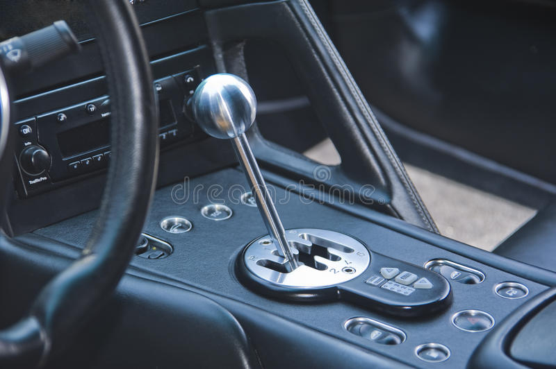 Gear shift lever. In exotic Italian sportscar with focus primarily on  and gate royalty free stock photos
