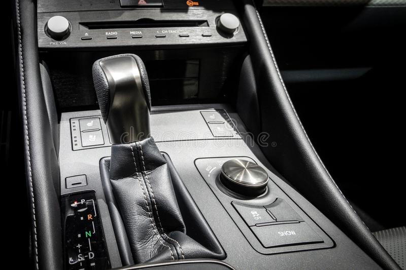 Gear shift modern car. Gear shift in the middle console of a modern car stock images