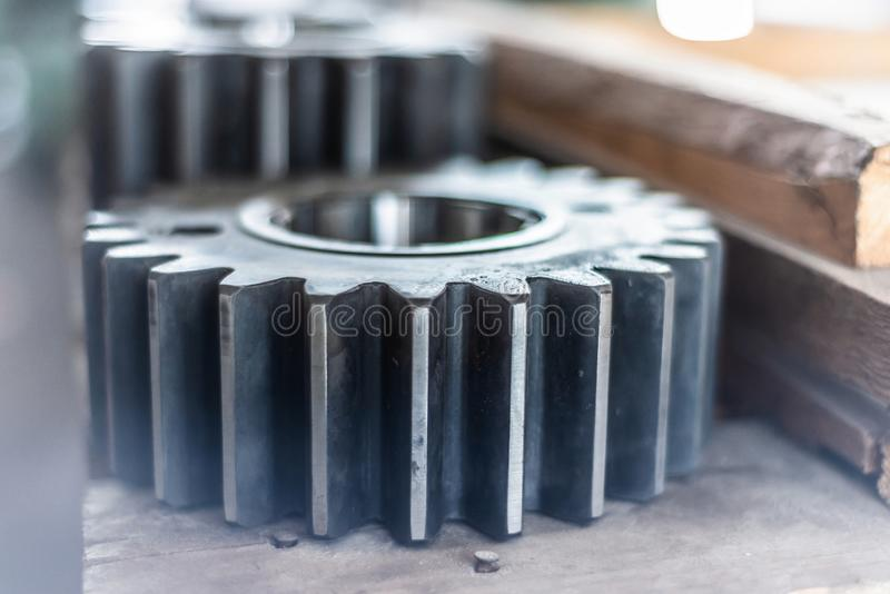The gear wheel after milling and grinding processing lie on the rack.  stock photography