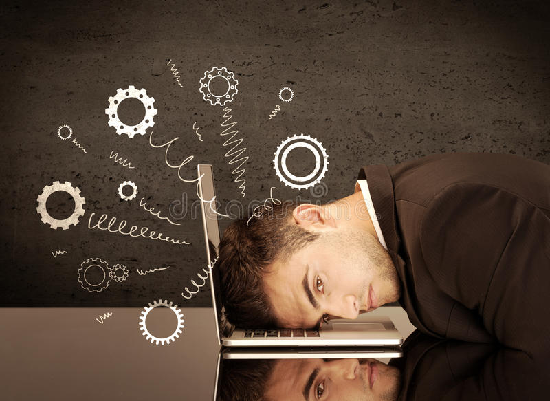 Gear wheels jumping from depressed head. Falling apart illustration concept with cranks, cog wheels springing from a fed up and tired businessman`s head resting royalty free stock photos