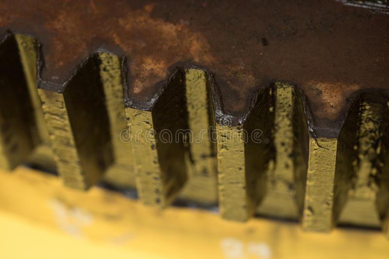Gear on wooden background, Machine parts or spare parts, industry background, old gear or damaged gear from hard work.  royalty free stock photography