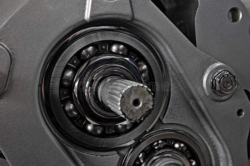 Gearboxes and bearings in an industrial machine. Full frame industrial background - metal gears and bearings in close-up stock photo