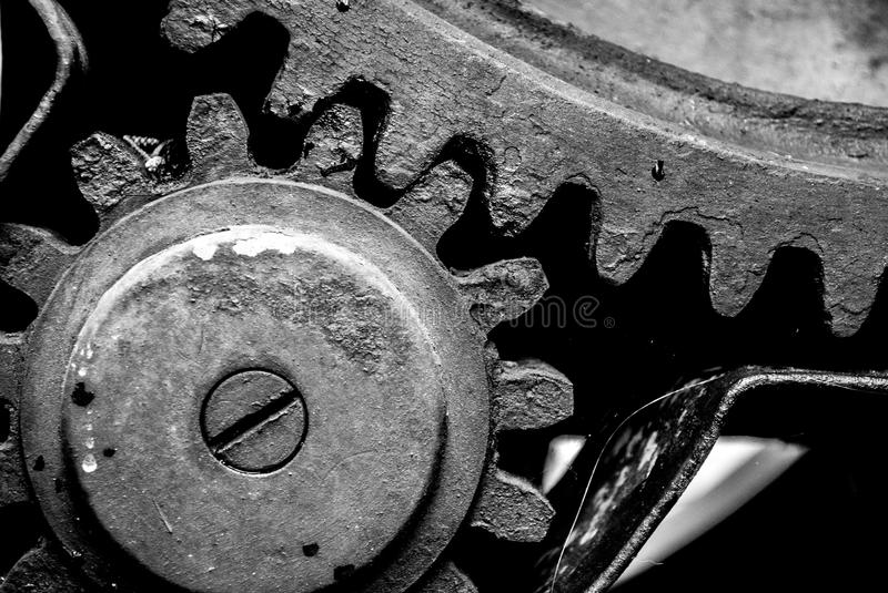 Gearing. Mechanical gear with a large toothed wheel of an old mill stock photography