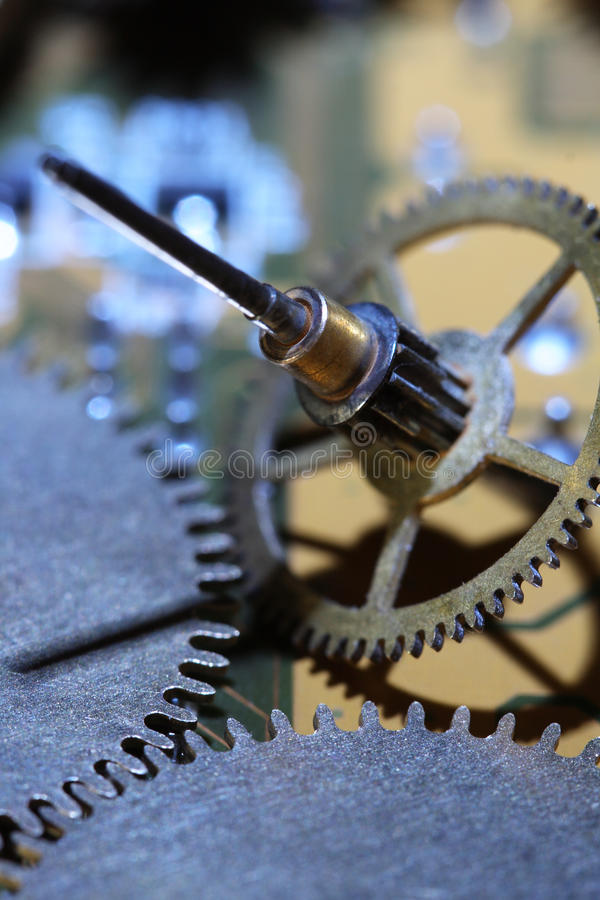 Gears. Extreme closeup of old assorted gearwheels on abstract dark background stock image