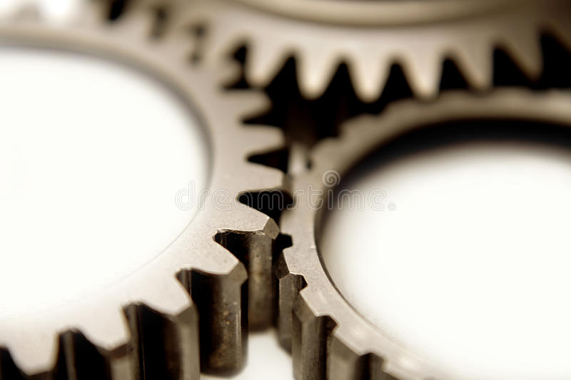Gears. Closeup of three gears over white stock images