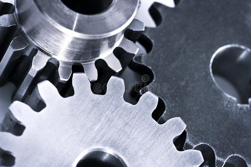 Gears. Industrial metal gears and machine parts connected royalty free stock photography