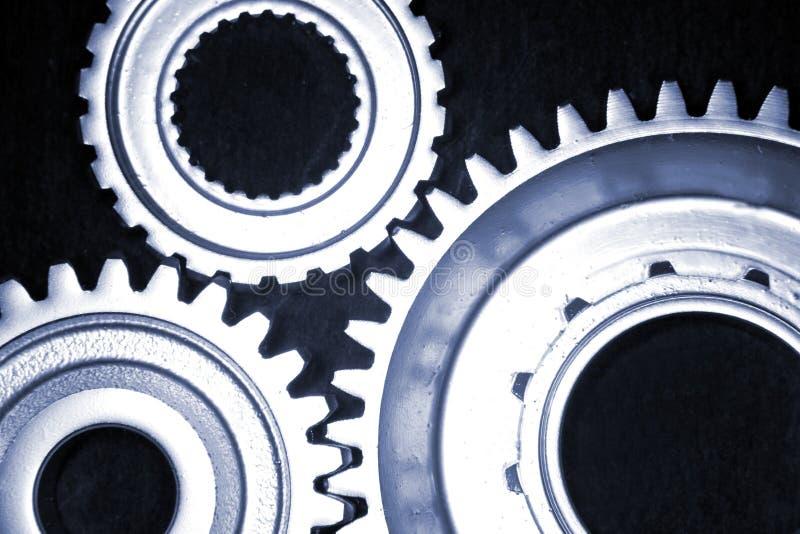Gears. Closeup of three steel gears royalty free stock photo