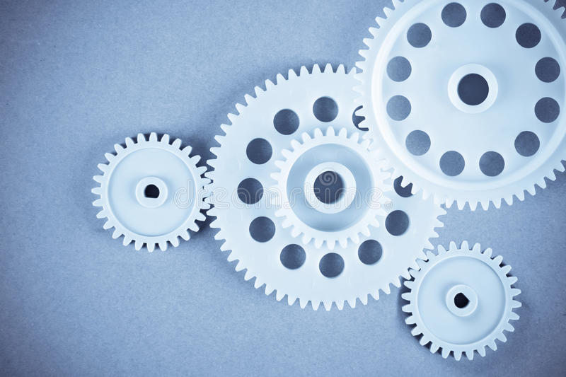 Gears. The gears meshing together(teamwork concept stock image