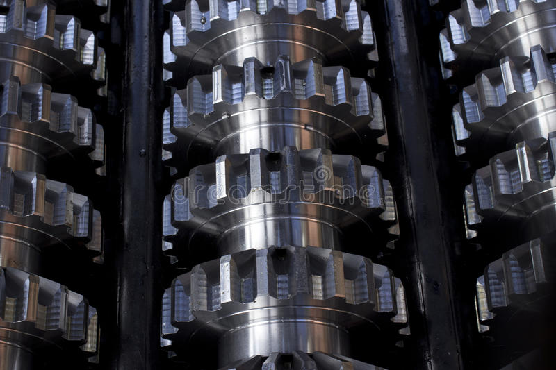 Gears. Row of cogs to be used in car industry, ready to be shipped, closeup stock images