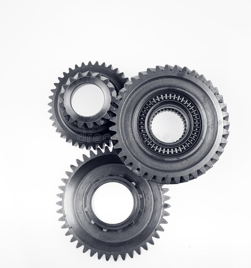 Gears. Three metal gears on plain background royalty free stock image