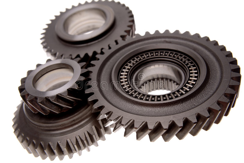 Gears. Three gears meshing together over white stock images