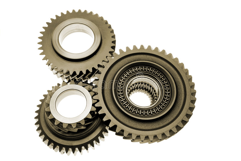Gears. Three metal gears over white stock photos