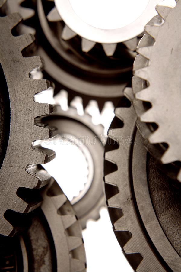 Gears. Steel gears working together over white stock photos