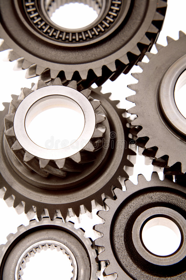 Gears. Steel gears working together over white royalty free stock photos