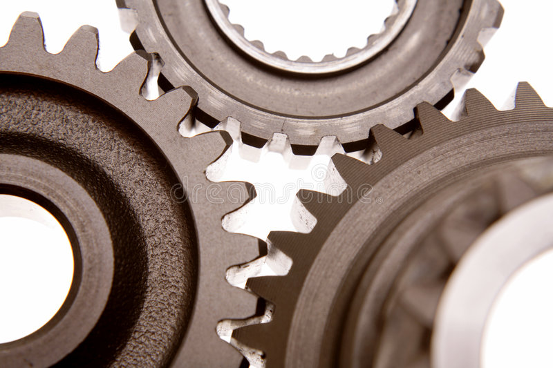 Gears. Three steel gears working together over white stock images