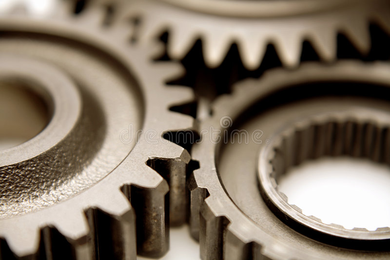 Gears. Connecting closeup, studio shot royalty free stock photography