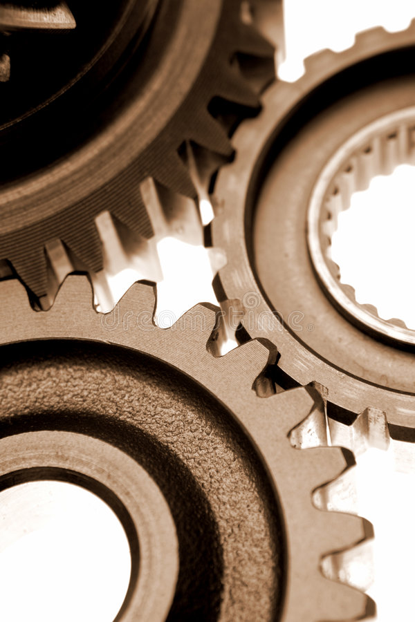 Gears. Three gears meshing together over white stock image