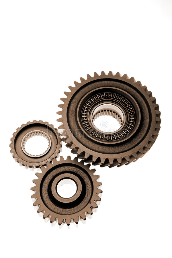Gears. Three metal gears isolated over white stock image