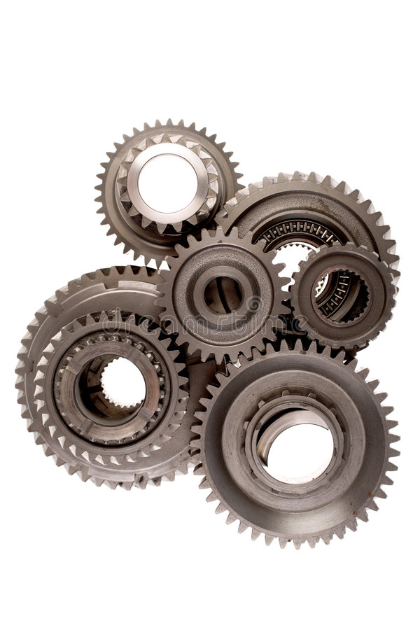 Gears. Assorted metal gears on white stock image