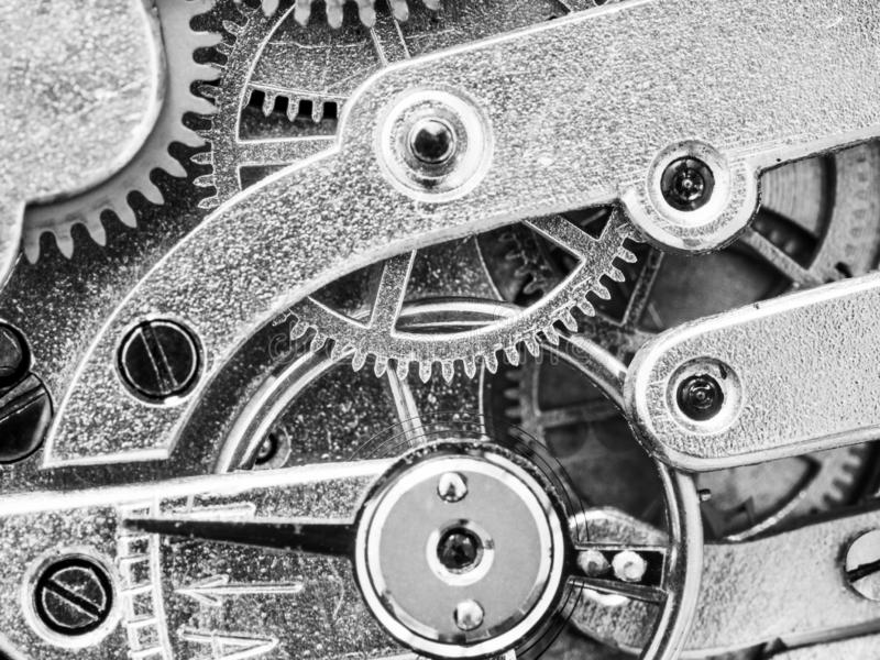 Gears in antique pocket watch close up. In black and white style royalty free stock photos