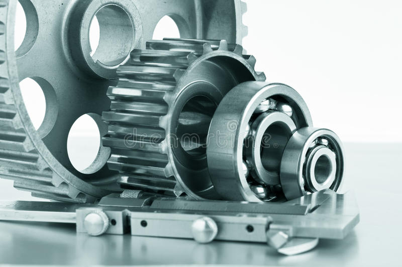 Gears and bearings with calipers. On a metal plate royalty free stock images