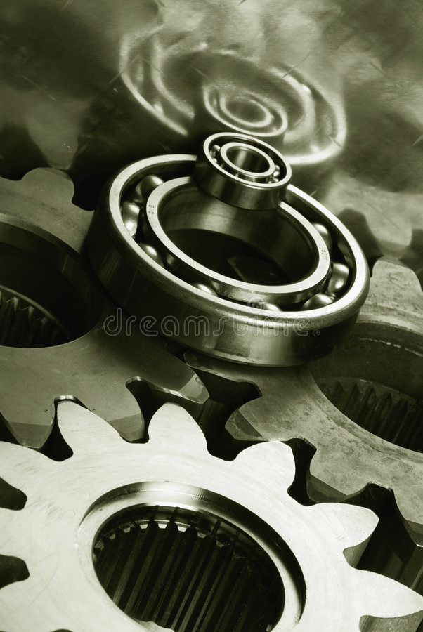 Gears and bearings in duplex effect stock images