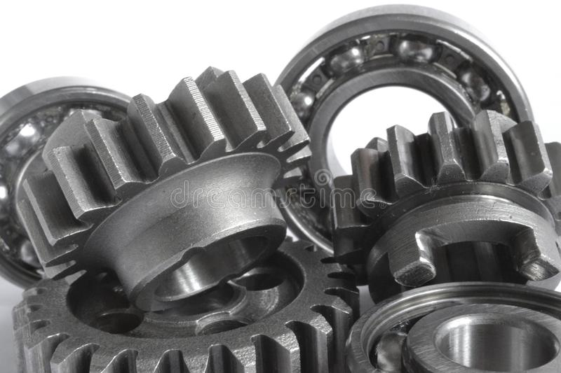 Gears and bearings. On the white background stock image