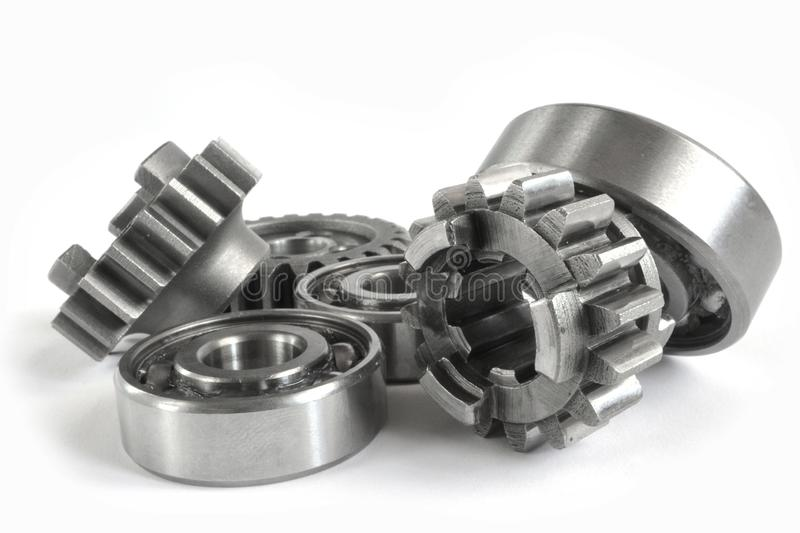 Gears and bearings. On the white background royalty free stock images