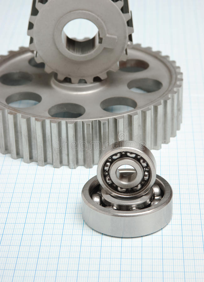 Gears and bearings. On graph paper stock images