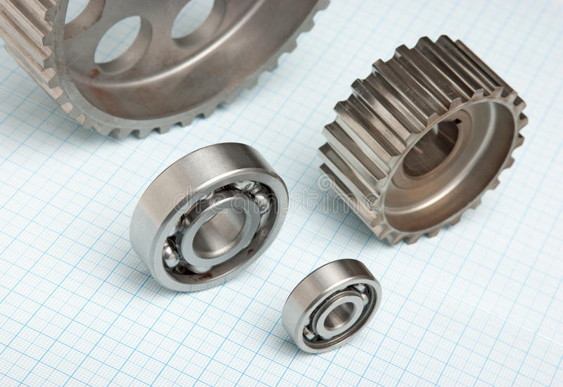 Gears and bearings. On graph paper royalty free stock photography