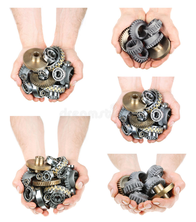 The gears and bearings. Set of photos hands hold a heap of bearings and a gears wheel on a white backgrounds stock images